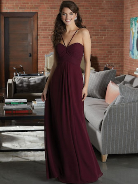 Mori Lee bridesmaid dress style number 21595. Chiffon Bridesmaid Dress Featuring a Ruched Sweetheart Bodice with V-Strap Detail. A Diamond Keyhole Back and Flowy A-Line Skirt with Pockets Complete the Look. Shown in Bordeaux.