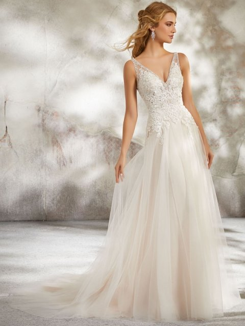 Lace and beaded bodice with straps and fitted waist to aline Morilee wedding dress under $2200